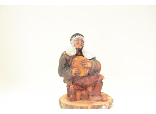 Old Man Marble Sculpture sitting playing music